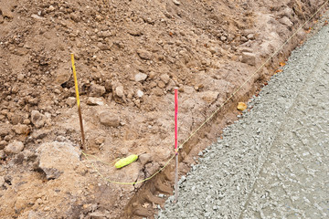 Strassenbau - Arbeiten mit der Richtschnur