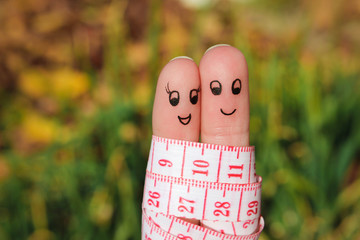 Finger art of a Happy couple with meter.