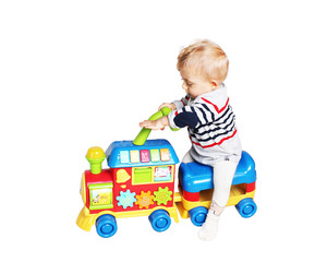 baby boy playing with train toy