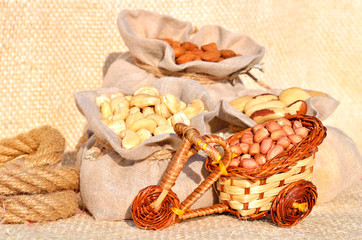 cashew nut, peanut, brazil nut in the bags on the sacking fabric