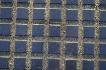 tile pattern on manhole cover