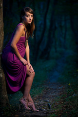 frightened Beautiful lady on a forest path at dusk