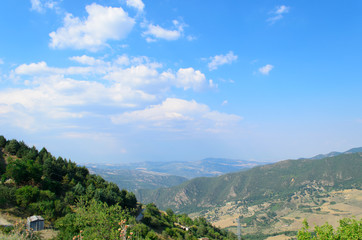 Mountain landscape in Basilicata with blue sky and clouds
