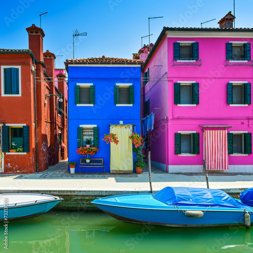 Venice landmark, Burano island canal, colorful houses and boat, - 73213003