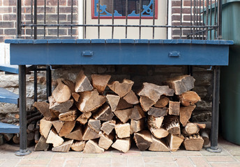 Firewood Pile Under Porch Deck