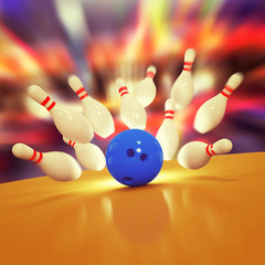 Scattered skittles and bowling ball