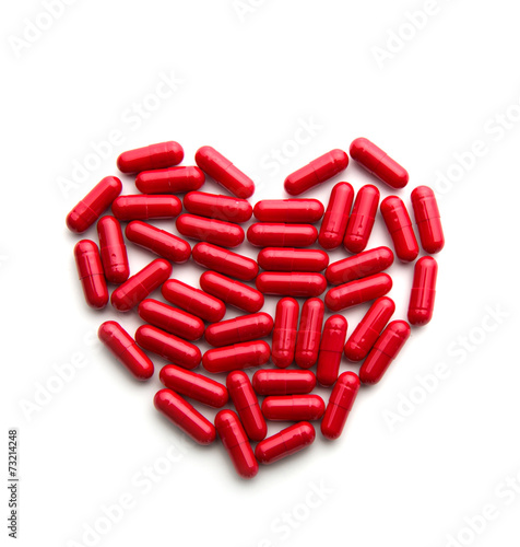 canvas print picture Red long pills in a heart form