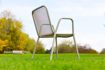 metal chair on a green lawn