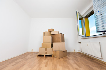 cardboard boxes in an empty apartment. moving to a new apartment