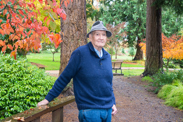 Active Senior Man in Autumn Arboretum and Garden