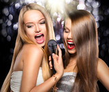 Fototapety Karaoke. Beauty girls with a microphone singing and dancing