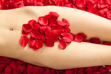 female body with white red rose petals