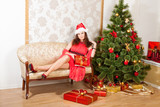 lass wearing red dress and Christmas hat poster