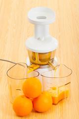 white slow juicer makes delicious fresh orange juice