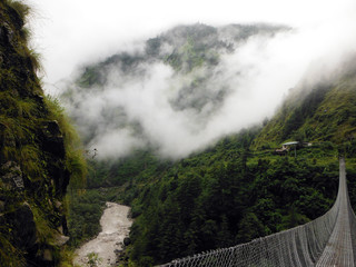 Green Himalayan Landscape with Suspension Bridge and River