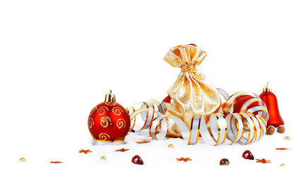 Red christmas ball and golden bag with gifts isolated on white b