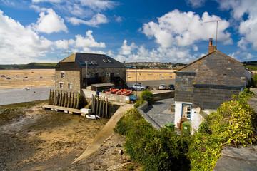 Sailing club and river Camel in low tide, Cornwall, UK.