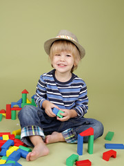 Child Playing with Blocks, Clothing and Fashion
