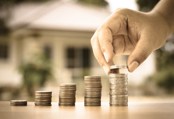 Male hand putting money coins stack like growing graph