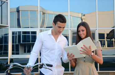 Couple looking at the tablet and smiles