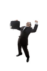 young happy businessman with suitcase celebrating work promotion