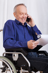 Disabled man talking on phone