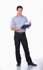 Young man standing with folder, isolated on white background