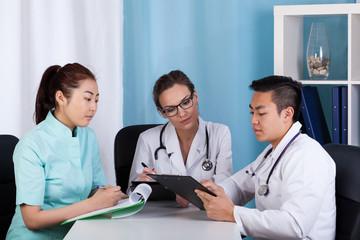 Doctors talking about patient