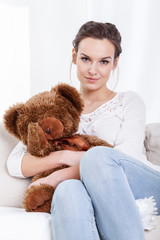 Mother sitting with teddy bear