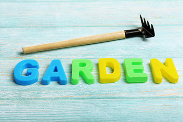 Garden word formed with colorful letters on wooden background