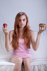 Choice between apple and doughnut