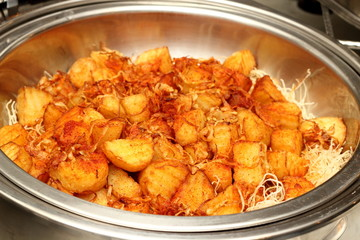 Fried potatoes served on a dish.