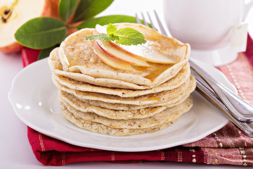 Stack of vegan pancakes with almond milk