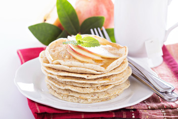 Stack of vegan pancakes with almond milk