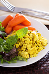 Scrambled tofu with salad leaves for breakfast