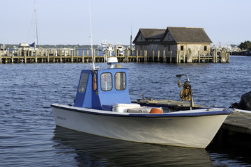 fishing boat in bay harbor marina Montauk New York USA the Hampt