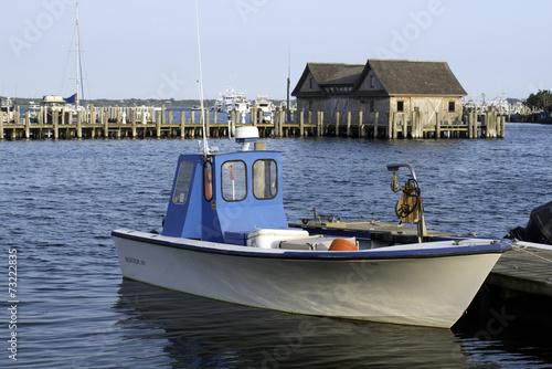 fishing boat in bay harbor marina Montauk New York USA the Hampt - 73222835