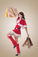Asian Christmas girl hold shopping bags