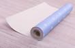 Roll wallpaper on floor