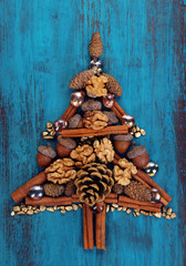 Christmas tree lined with cones and cinnamon on table