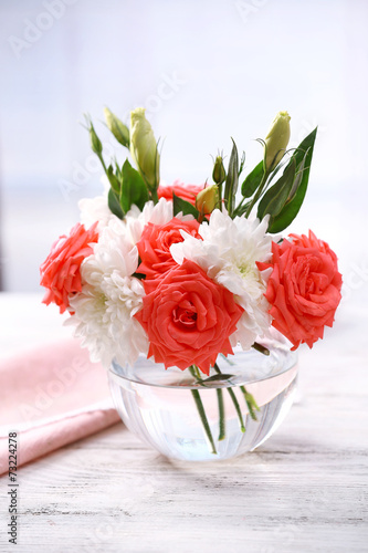 canvas print picture Beautiful flowers in vase with light from window