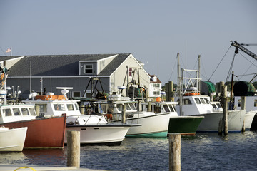 fishing boats in bay harbor marina Montauk New York USA the Hamp