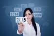 Businesswoman pressing high tech button
