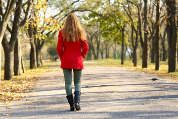 Lonely woman walking in park