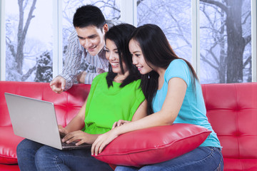 College students using laptop at home