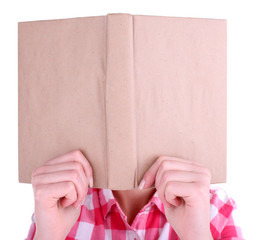 Girl reading book covering her face isolated on white