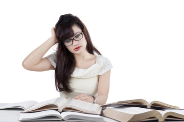 Confused student reading many books 2