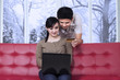Couple paying online at home