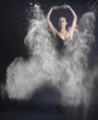 Dancing woman and flying dust.
