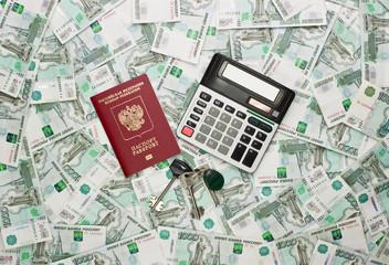 Money, calculator, passport and keys